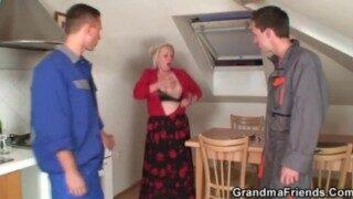 Two repairmen bang busty grandma from both ends